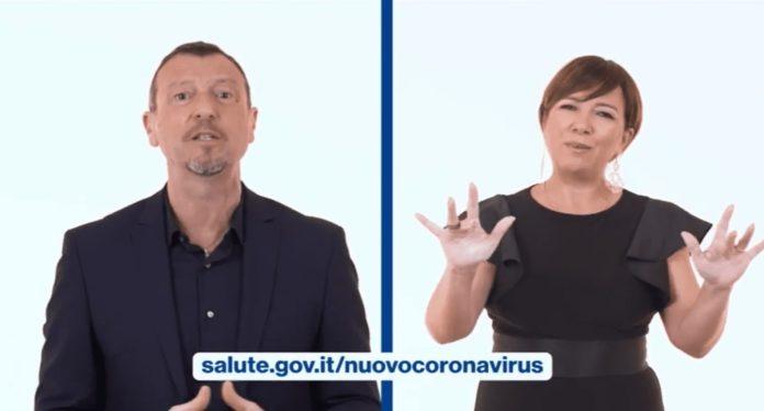 amadeus e interprete LIS spiegano pratiche contro coronavirus italia