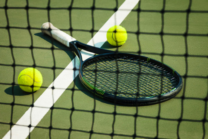 racchetta da tennis in carrozzina